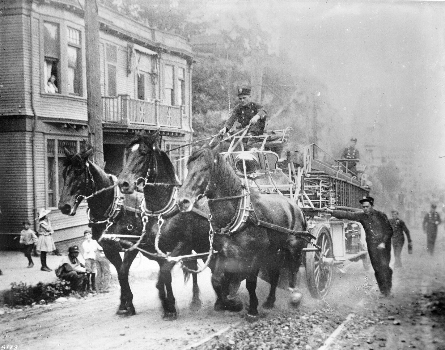 Three muscular horses pull a Los Angeles fire engine up a First Street Hill, circa 1900. Courtesy of the USC Libraries - California Historical Society Collection.