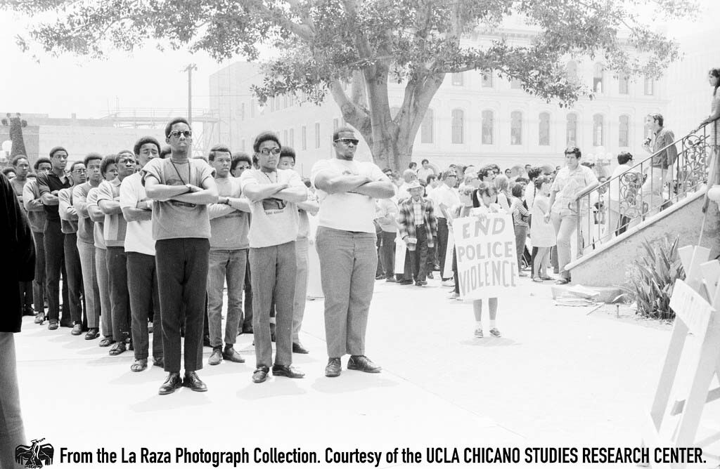 """CSRC_LaRaza_B1F4C8_Staff_004 The US Organization, founded by Maulana (Ron) Karenga, marches in support of the LA 13. """"The black community assisted us throughout our struggles,"""" comments Joe Razo 