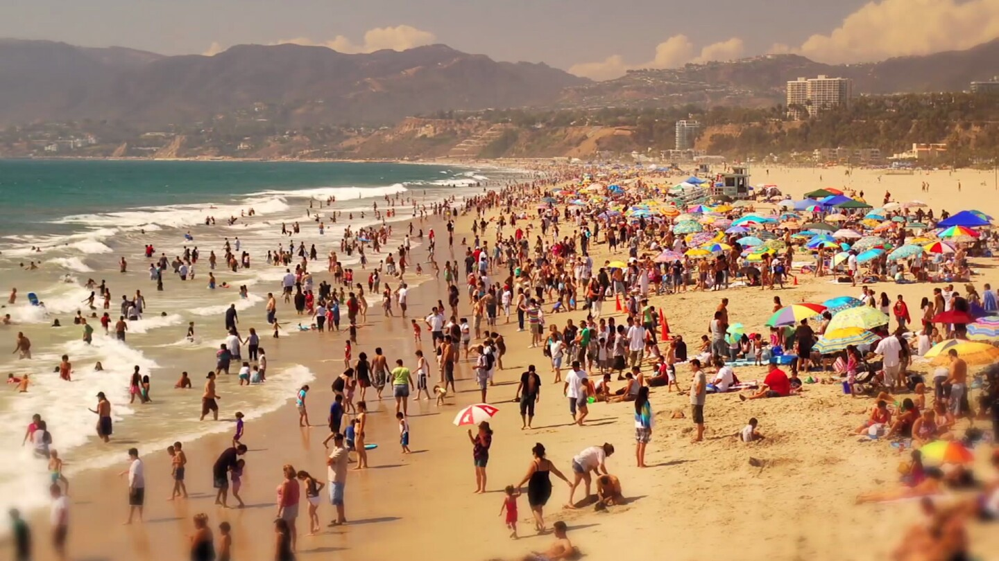 A beach in Los Angeles is bustling with people.