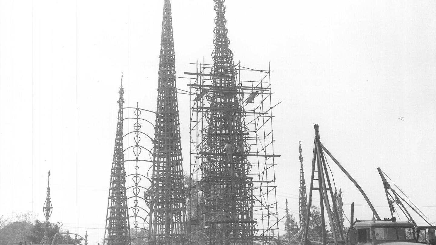 A crowd watches structural testing of the Watts Towers, July 1959