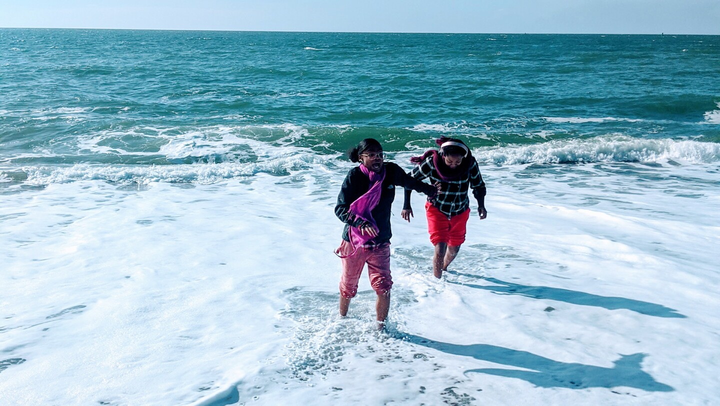 Californians for Justice youths at the beach and playing in the water. It is a rare experience for many to just be able to relax since many are juggling multiple responsibilities created by social and economic systems. | Californians for Justice
