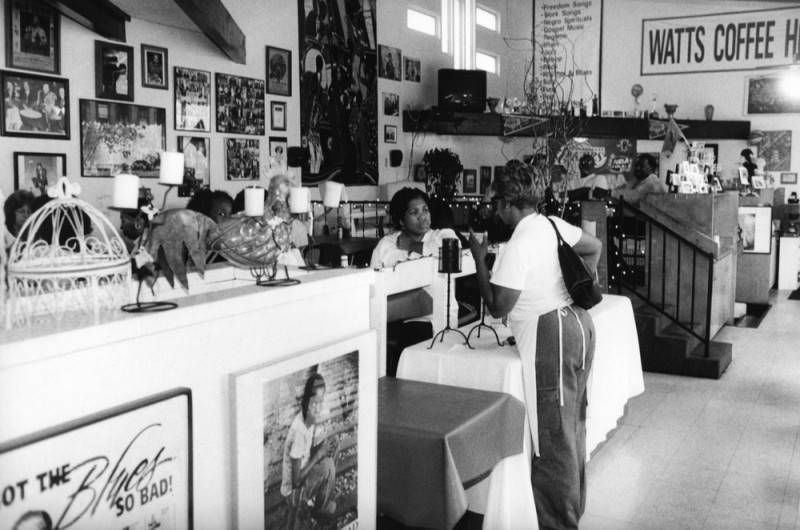 Desiree Edwards chat with customers at Watts Coffee house in the Mafundi Community Center | Los Angeles Neighborhoods Collection, Los Angeles Public Library