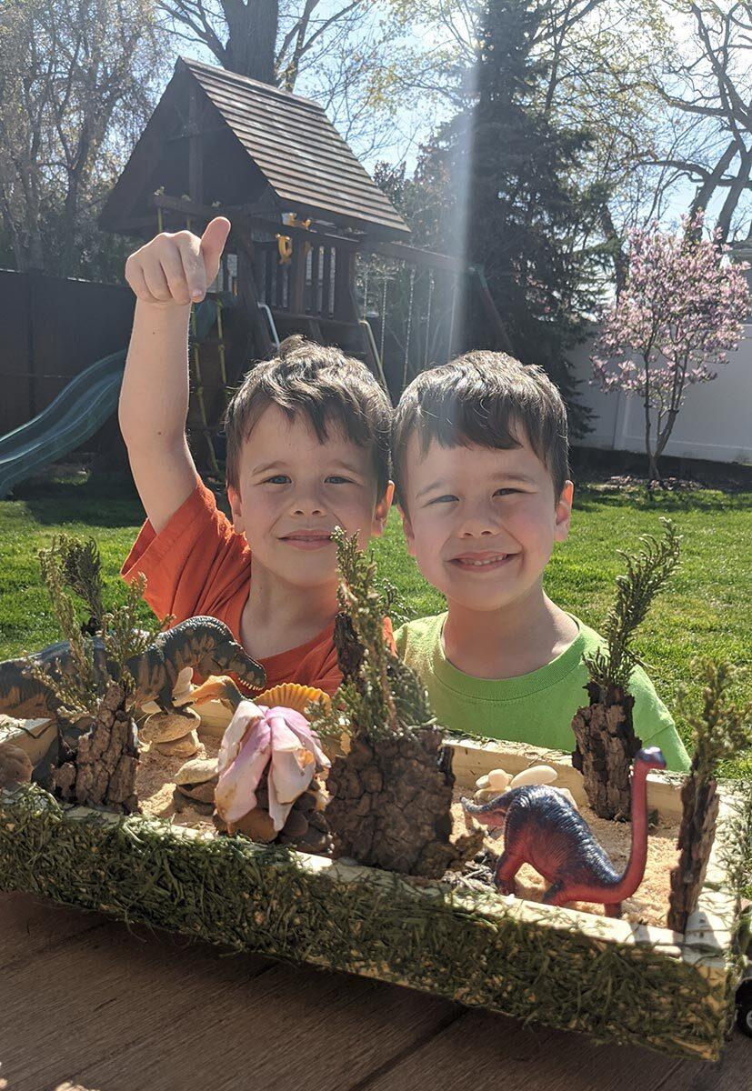 The Kerley children show off their dinosaur-themed float.