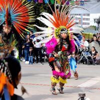 From left to right: Mayahuel and Ocelotl dance with their mother, Lupe Tellez.   Courtesy of Lupe Tellez
