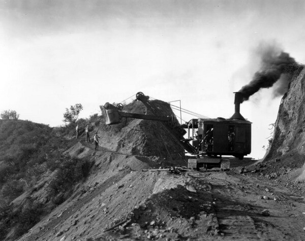 A steam shovel grades the summit of Mount Hollywoodland, circa 1925. Courtesy of the Security Pacific National Bank Collection - Los Angeles Public Library.
