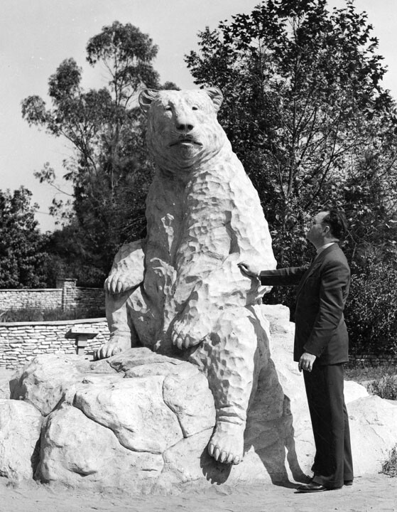 A man poses with a life-size reconstruction of a short-faced bear near the La Brea Tar Pits, where remains of the animal were recovered. Courtesy of the Security Pacific National Bank Collection, Los Angeles Public Library.