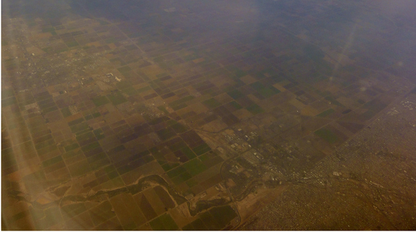 Aerial view of, or through, Calexico and Mexicali's air pollution | Creative Commons photo by Omar Barcena