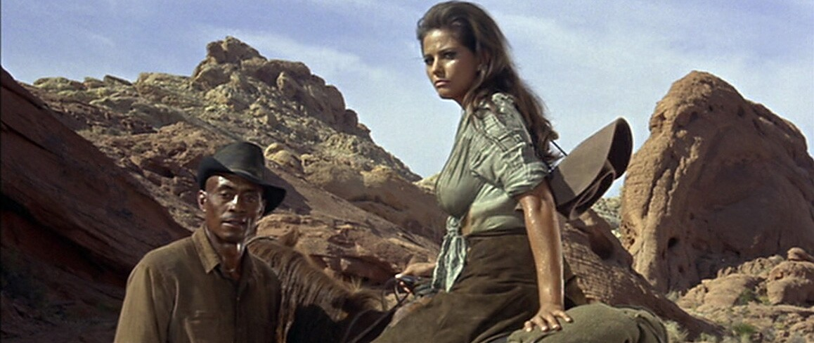 """Claudia Cardinale and Woody Strode are pictured against Nevada's Valley of Fire in Richard Brooks' 1966 film, """"The Professionals,"""" that also starred Lee Marvin, Burt Lancaster, Robert Ryan and Jack Palance. Columbia Pictures."""