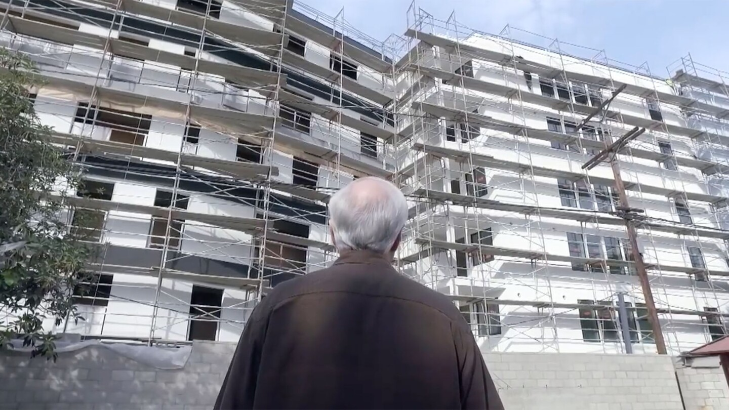 Man Looks at Housing Development in his Backyard in Westchester