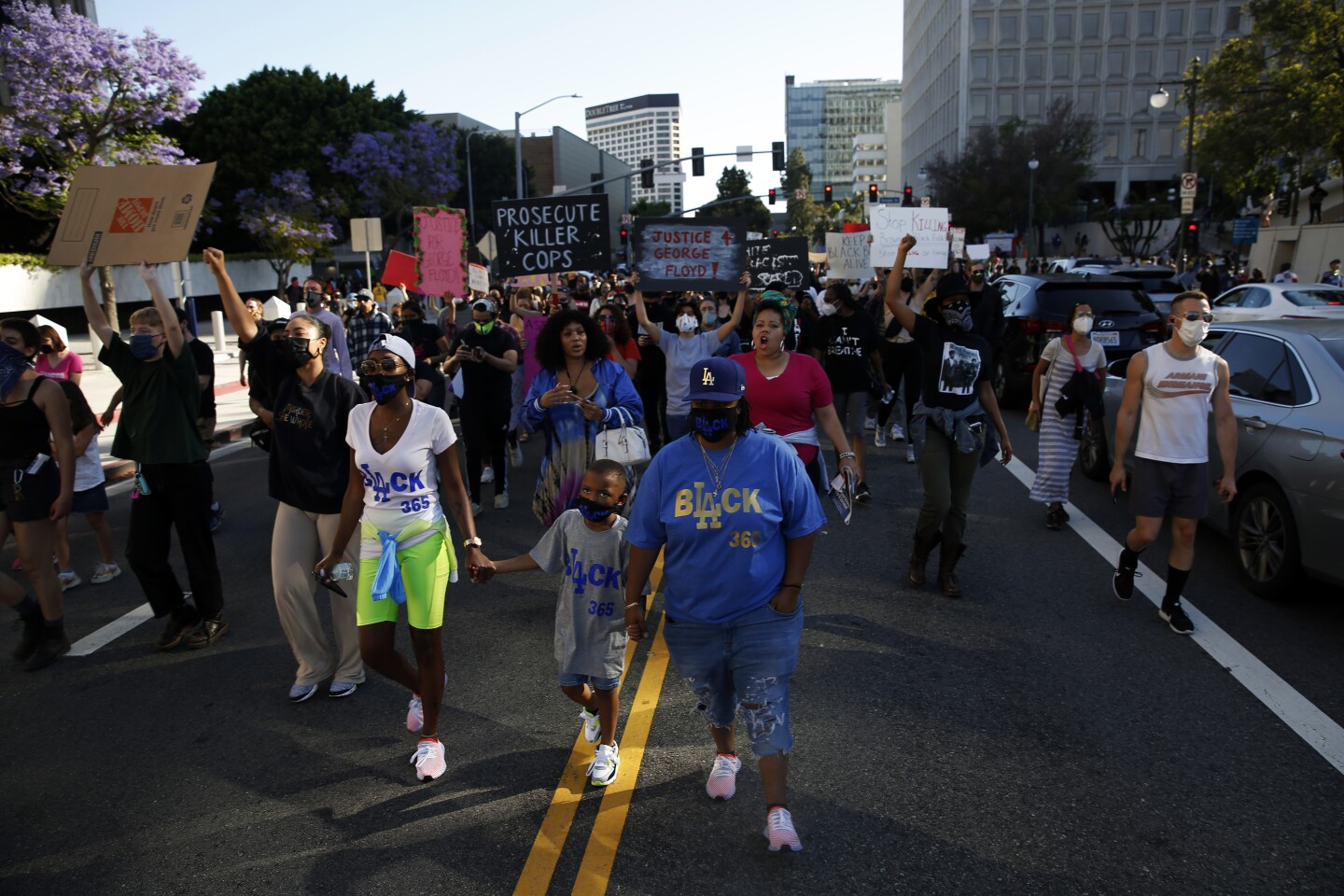 Families take to the streets during a Black Lives Matter protest in downtown Los Angeles. | Dania Maxwell / Los Angeles Times via Getty Images