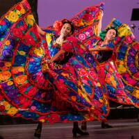 Ballet Folklórico de Los Ángeles dancers in vivid pink dresses dance Mexican ballet folklórico in Nochebuena at The Soraya accompanied by music from Mariachi Garibaldi de Jaime Cuéllar on Dec. 14, 2019. | Luis Luque