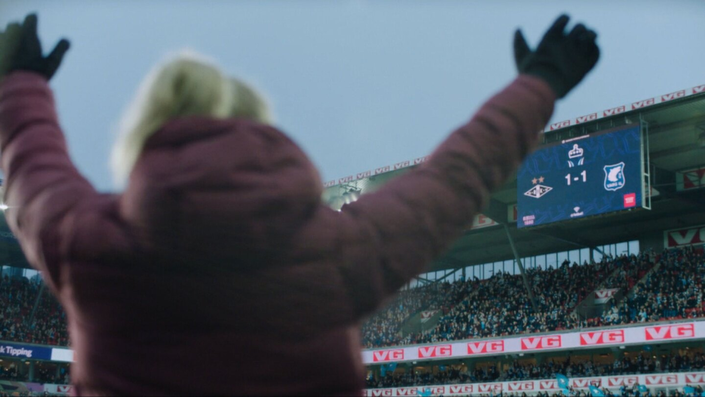 "Helena raises her arms up as she's looking at the scoreboard that reads 1-1. | ""Home Ground: Never Walk Alone"""