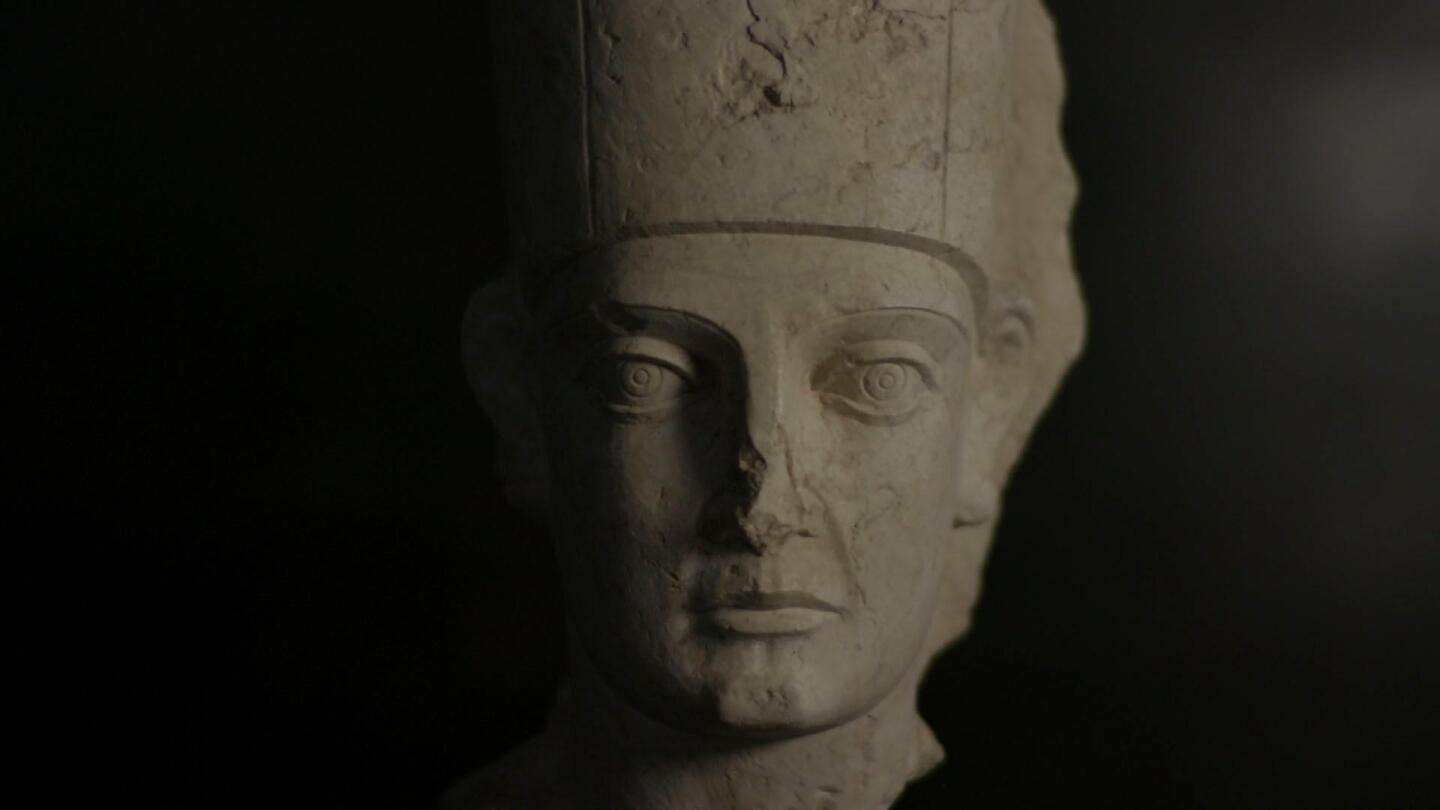 "Closeup of a statue's face featured in ""Civilizations: The Second Moment of Creation."""