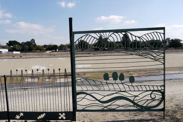 Decorative gates lead park visitors directly to the San Gabriel River and its bike paths | Photo: Yosuke Kitazawa.
