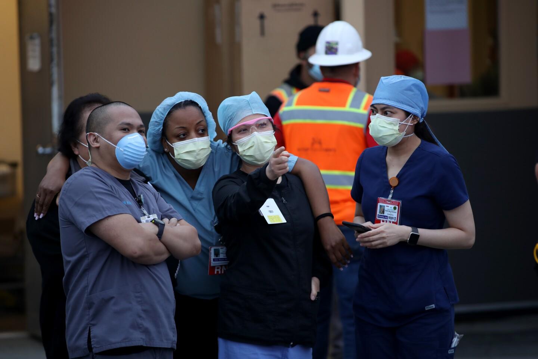 Nurses stand outside of Kaiser Hospital