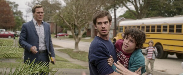 Michael Shannon, Andrew Garfield and Noah Lomax in 99 Homes
