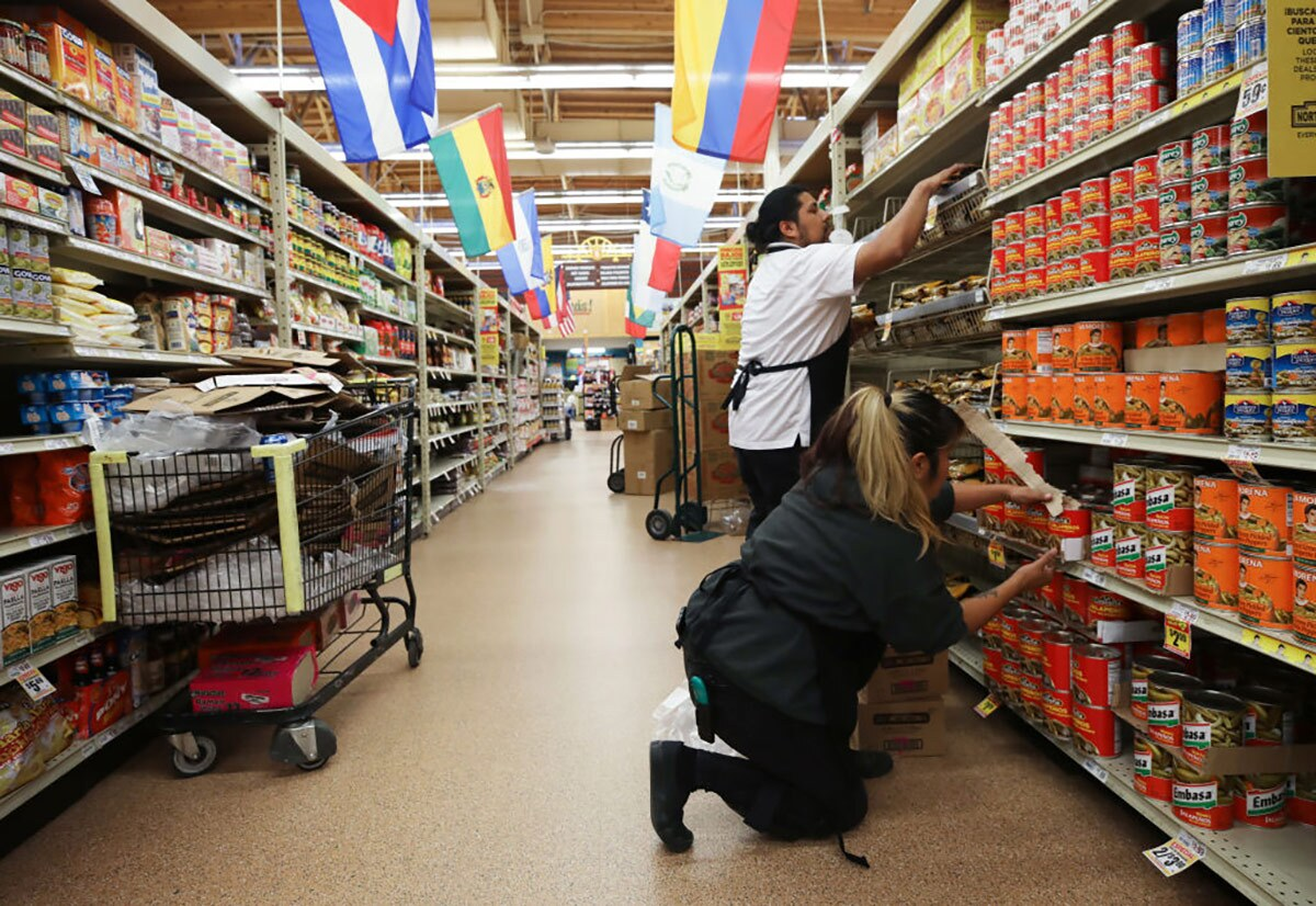 Workers re-stock items during special hours open only to seniors and the disabled at Northgate Gonzalez Market, a Hispanic specialty supermarket, on March 19, 2020 in Los Angeles, California.