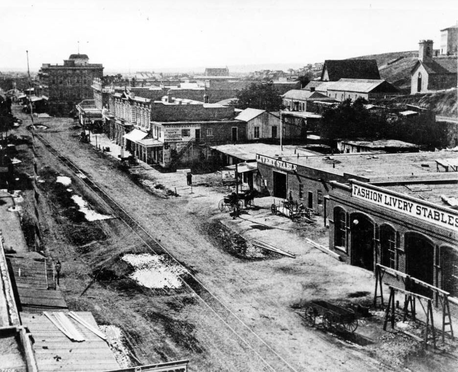 Stables occupy prime commercial real estate in this 1874 view of Main Street, just north of Temple. Courtesy of the USC Libraries - California Historical Society Collection.