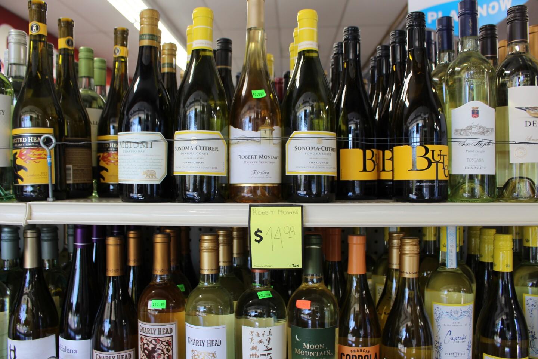 Close up on wine bottles in liquor store   Karen Foshay