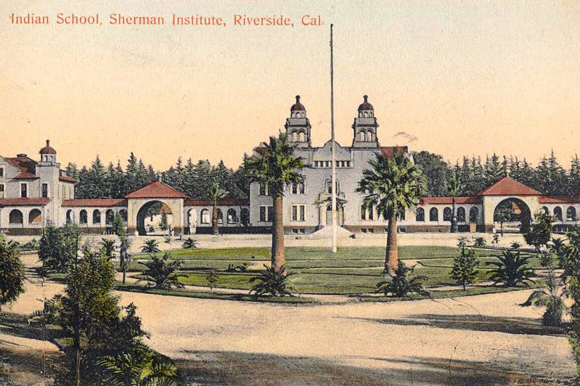 A vintage postcard showing the Mission Revival architecturally styled Sherman Institute, Riverside, CA. Credit: Sherman Indian Museum.