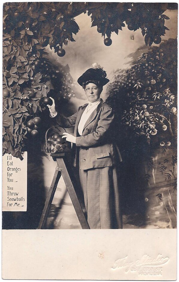 A photo souvenir postcard shot at Pasadena's Flag Studio, which had an artificial orange tree next to which tourists could pose. Courtesy of the David Boulé Collection.