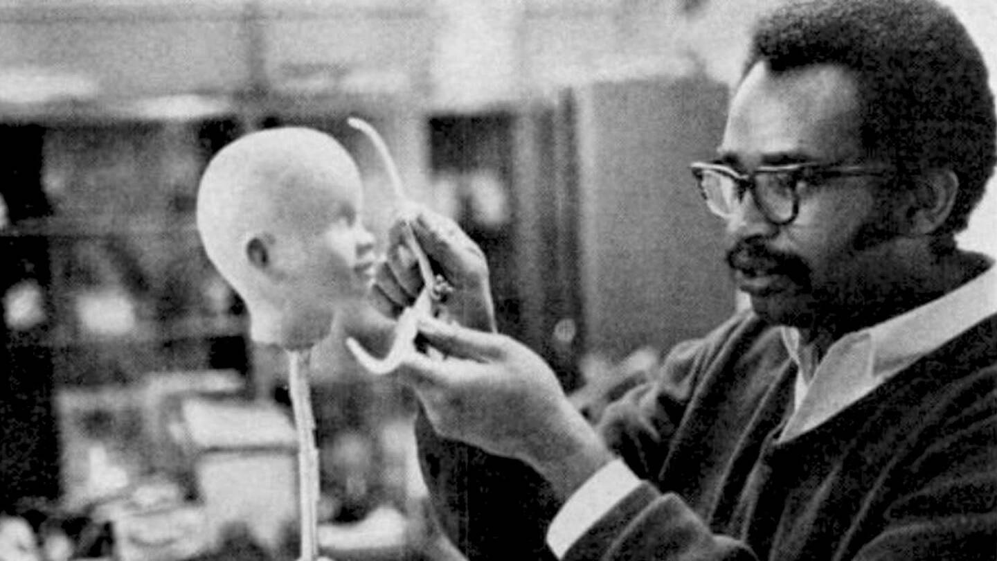"A man sculpting a Shindana Toy doll head from a Jet Magazine story published by Johnson Publishing Company | Still from ""Lost LA"" Shindana Toys"