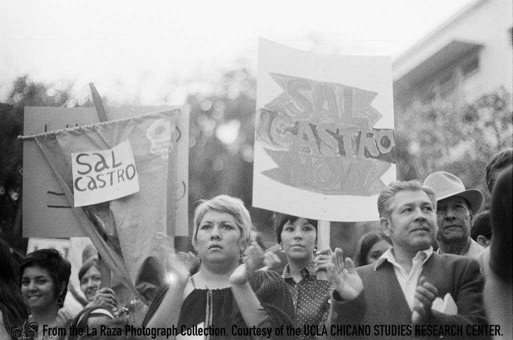 CSRC_LaRaza_B1F6C2_LG_021 Protesters and Pedro Arias, La Raza staff photographer, demand reinstatement of Sal Castro | Luis Garza, La Raza photograph collection. Courtesy of UCLA Chicano Studies Research Center