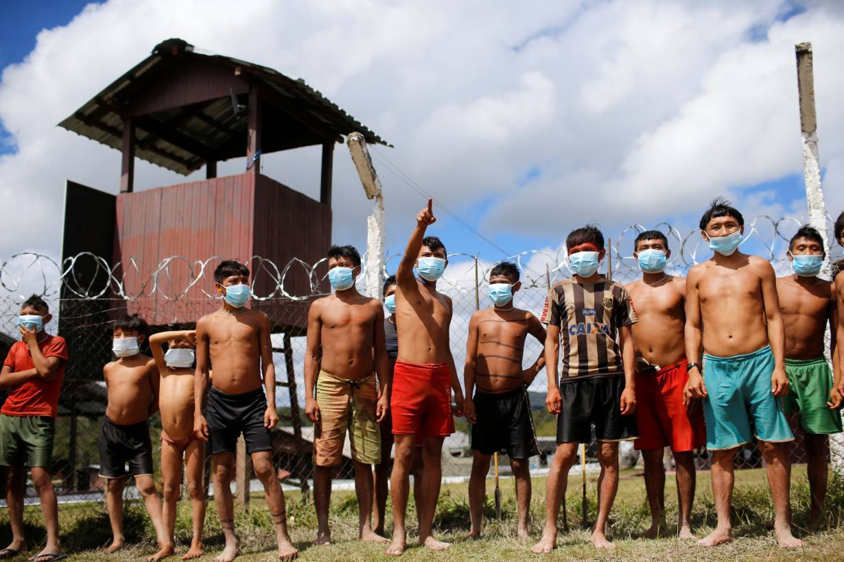 Indigenous people from Yanomami ethnic group are seen amid the spread of the coronavirus disease (COVID-19) in Brazil July 1, 2020. | REUTERS/Adriano Machado