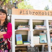 Sarah Rafael García poses next to her LibroMobile mobile library. | Courtesy of Sarah Rafael García