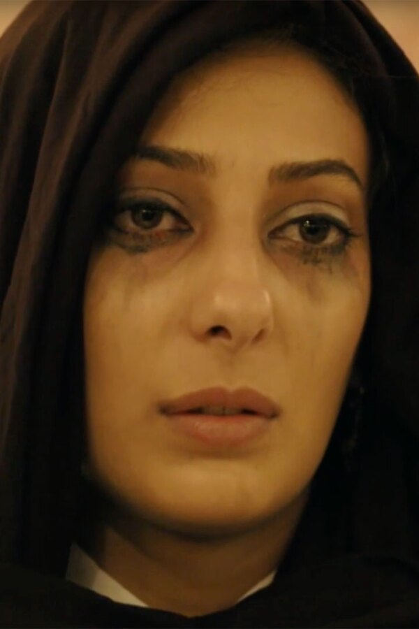 "Woman with mascara running, wearing black scarf. | Still from ""Fauda"""