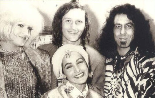 Clockwise from center, Jon Bok, Billy Shire, Jane Wiedlin and Summer Caprice at the Jon Bok Opening in 1987. It's a black and white archival photo.