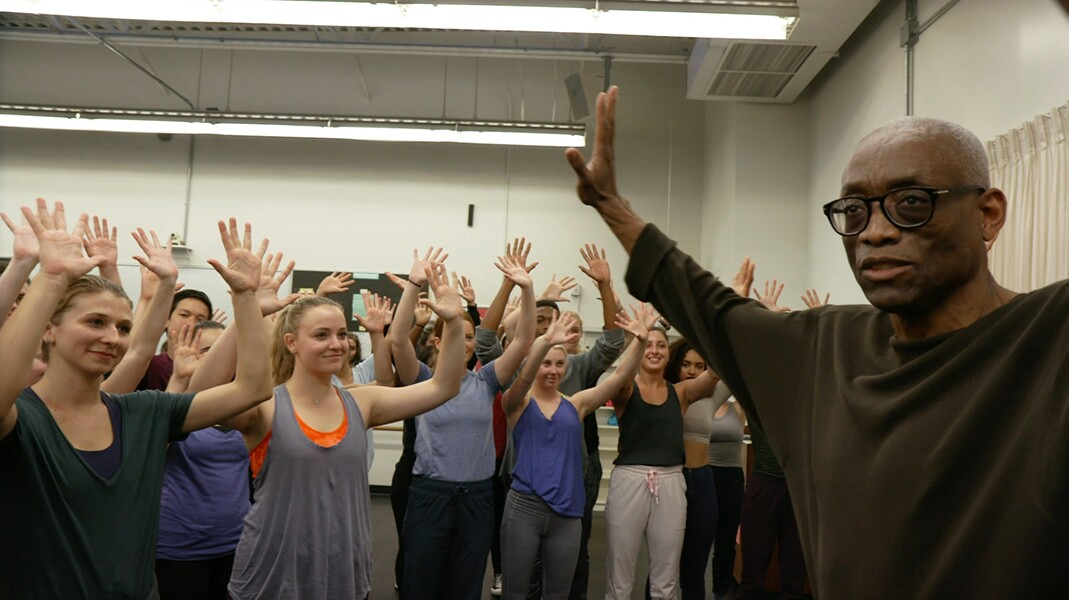 Bill T. Jones in rehearsal with Loyola Marymount University (LMU) students with arms raised in 2016. | Courtesy of Rosalynde LeBlanc