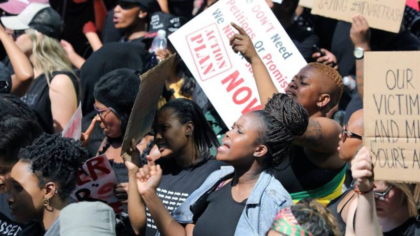FILE PHOTO: Women hold placards as they protest against gender-based violence, outside the Johannesburg Stock Exchange in Sandton, Johannesburg, South Africa, September 13, 2019. | REUTERS/Marius Bosch