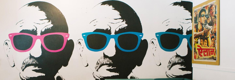 3 Ghandis wearing sunglasses mural at Badmaash