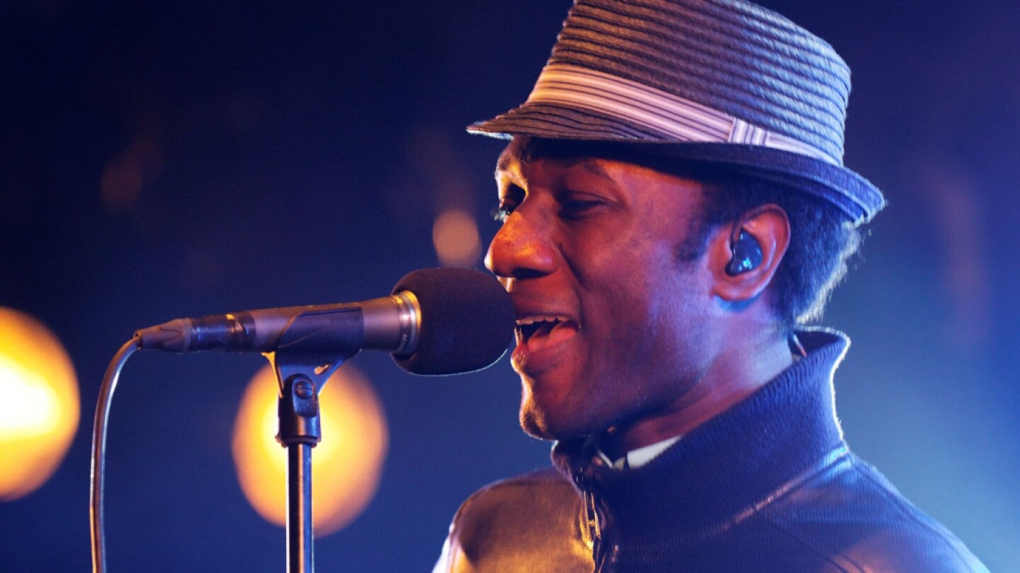 Aloe Blacc performing on stage