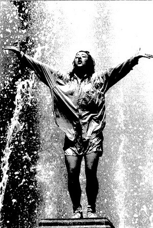''Professional visualizer'' Suzy Coyle dances in the fountain, 1988