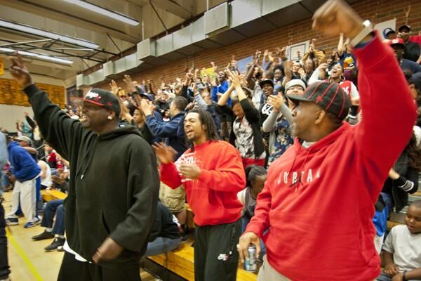 Fans cheering Tatyana Calhoun   Photograph by Douglas McCulloh