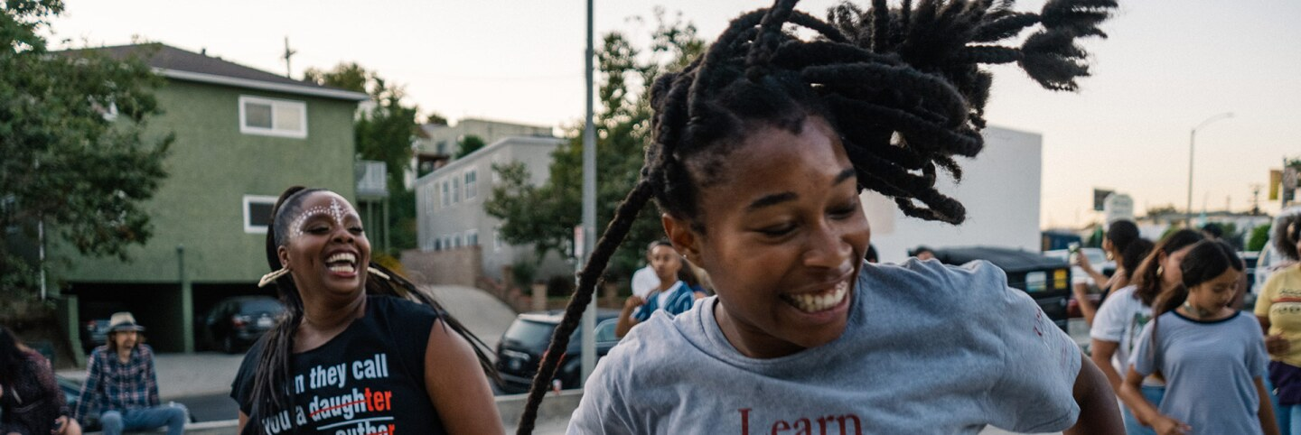 """""""Fuck White Supremacy, Let's Get Free"""" by Patrisse Cullors. Performance documentation from August 10, 2019. 