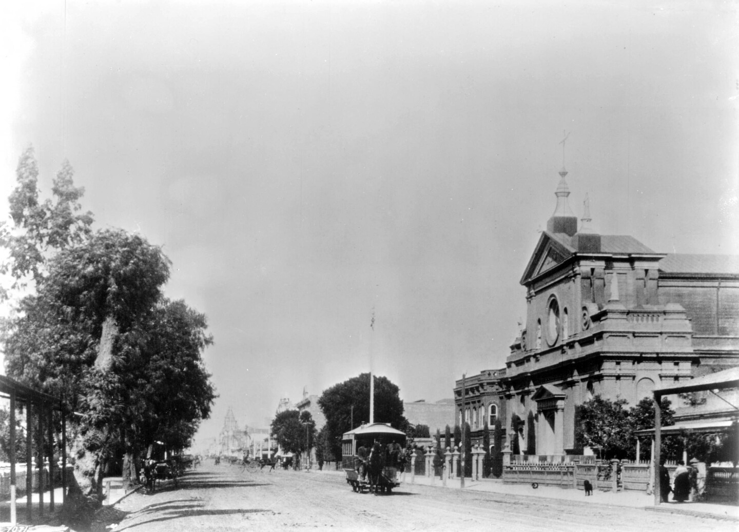 A Main Street and Agricultural Park horse-drawn streetcar rolls past St. Vibiana's Cathedral on Main Street in 1884. Courtesy of the Title Insurance and Trust, and C.C. Pierce Photography Collection, USC Libraries.