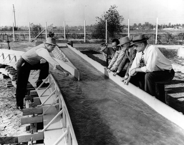 Edward Koehn, Chief of flood control design for the Los Angeles district, explains the model to colleagues, 1948. Courtesy of the Los Angeles Public Library.