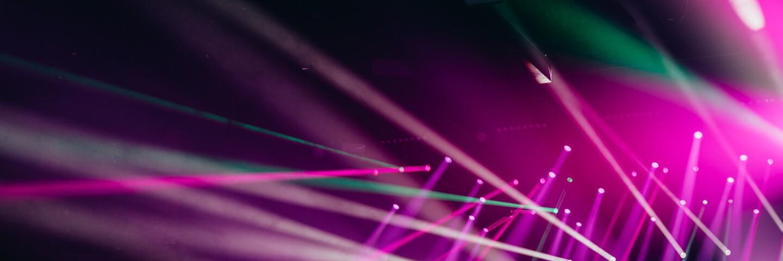 Purple and blue stage lights | David von Diemar / Unsplash