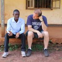 "Henry (left) and Jim (right) chat in Uganda. | ""Remand"""
