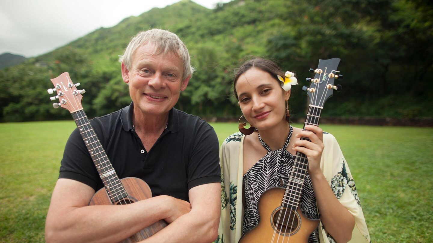 """Martin Clunes poses with a woman wearing a flower in her hair in a promo image of """"Martin Clunes' Islands of America."""""""
