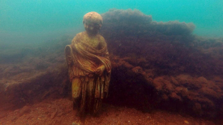 """A sunken statue underwater.   From """"Secrets of the Dead: Nero's Sunken City"""""""