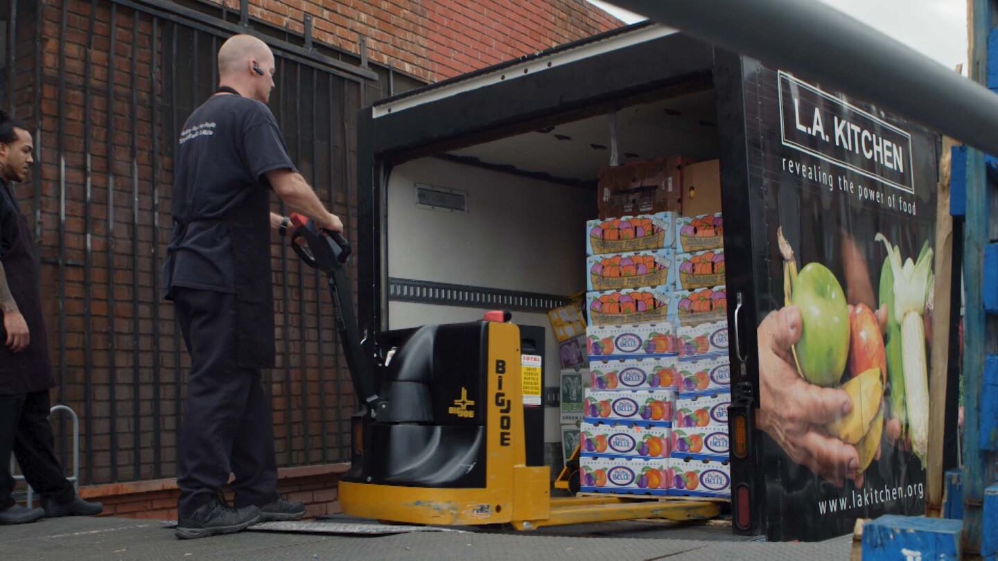 "An L.A. Kitchen employee unloads pallets of produce rejected by the grocery store. | Still from ""Broken Bread"""