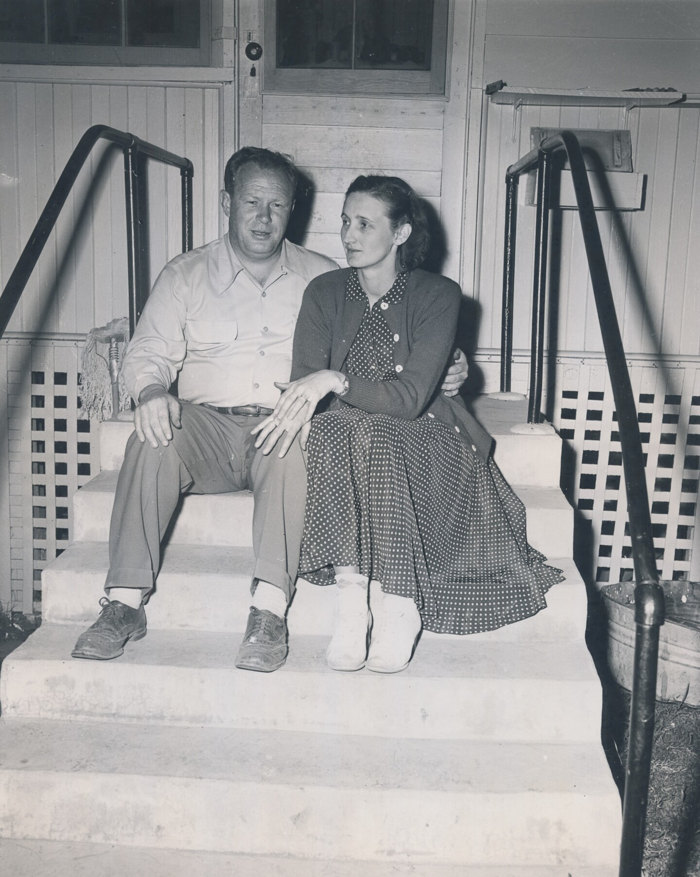 The married couple, Dave and Alice Fiscus, sit together on some steps for a photo.