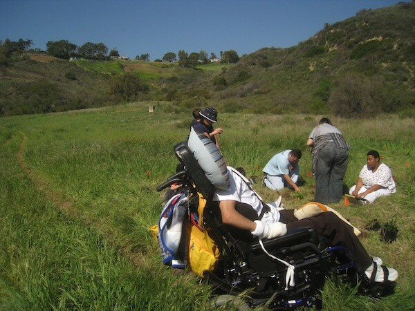 Educational service learning opportunities, such as this Zuma Canyon planting with a special needs group in 2009, may be cut. | Photo: Zach Behrens/KCET
