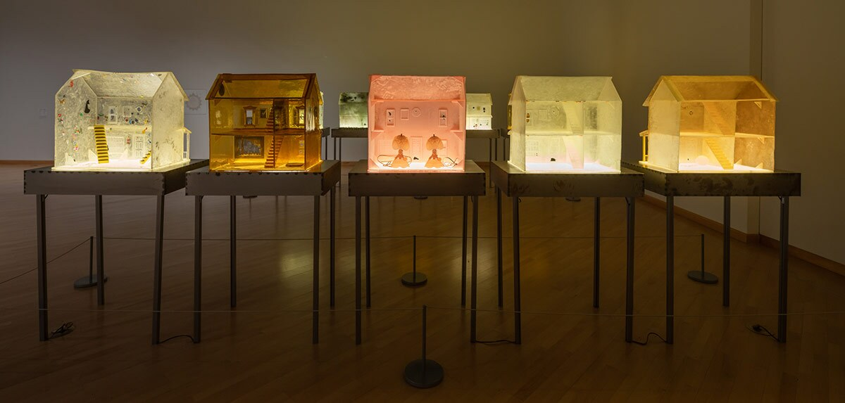 "Installation view of ""Sula Bermúdez-Silverman: Neither Fish, Flesh, nor Fowl"" at CAAM featuring colorful dollhouses made of sugar. 