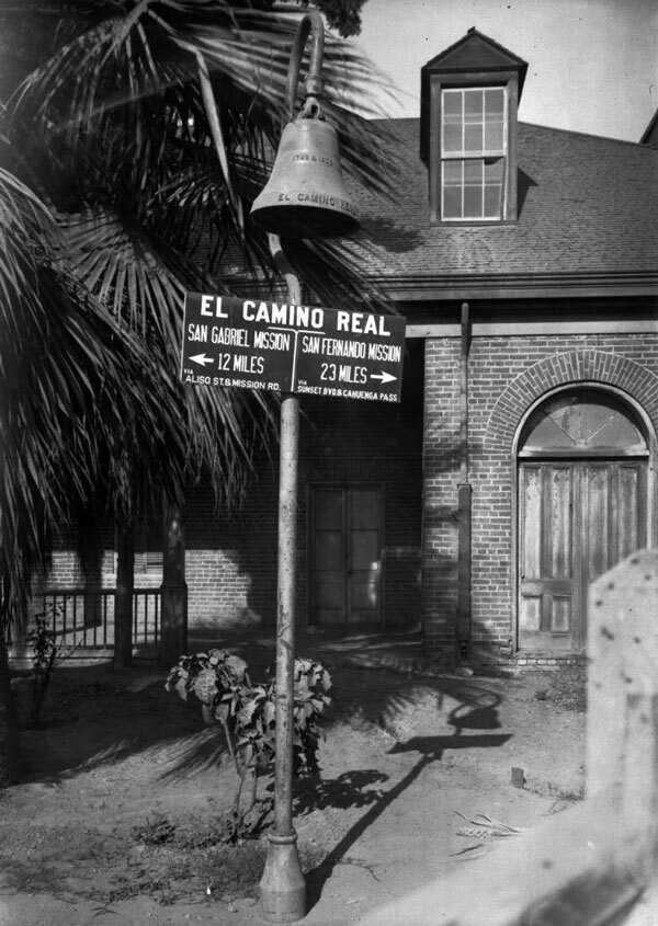 The first El Camino Real bell was erected on August 14, 1906 outside the Plaza Church in Los Angeles. Courtesy of the Title Insurance and Trust, and C.C. Pierce Photography Collection, USC Libraries.