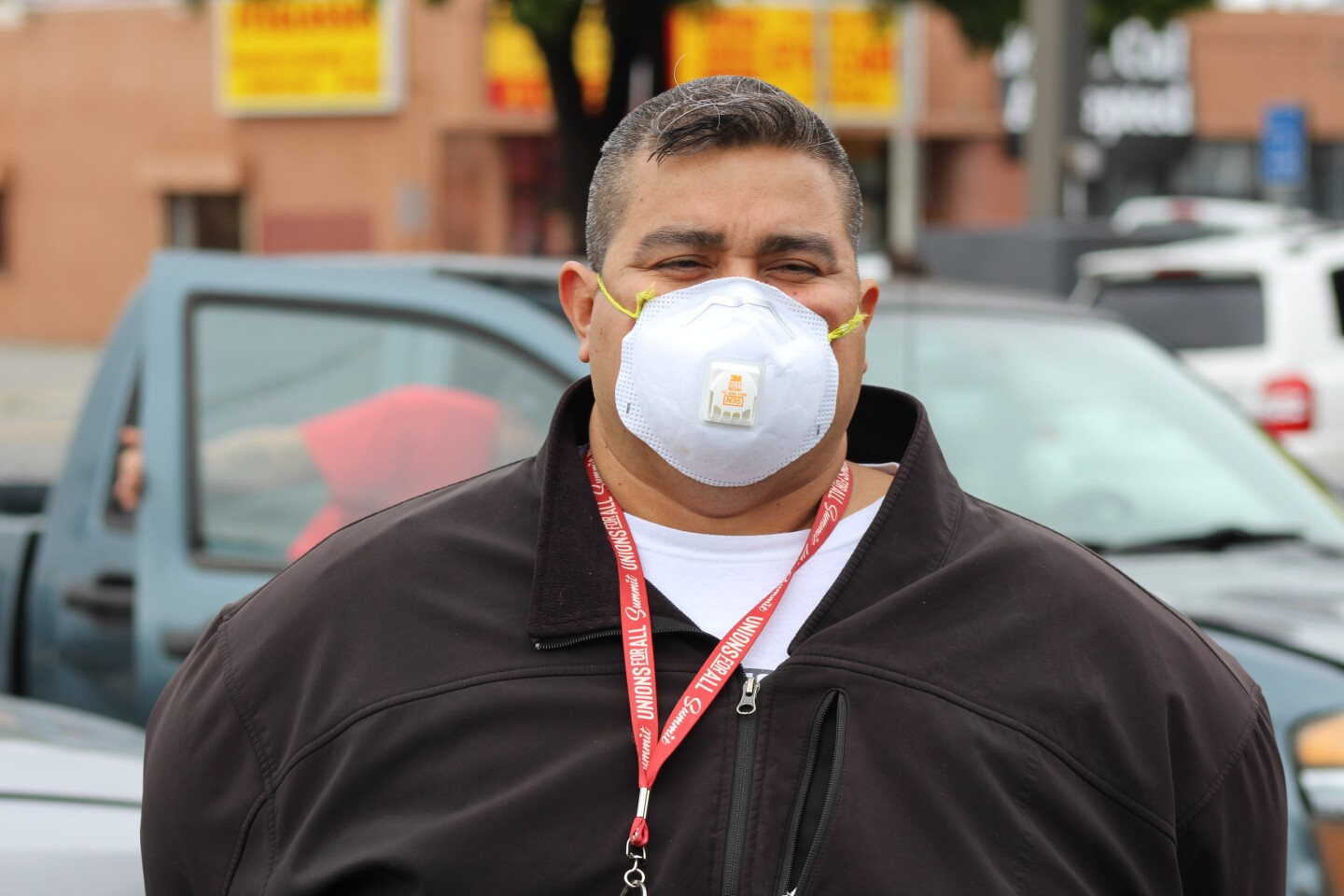 Man wearing a mask wearing a Unions for All lanyard, during protest at McDonalds on April 6, 2020 | Karen Foshay